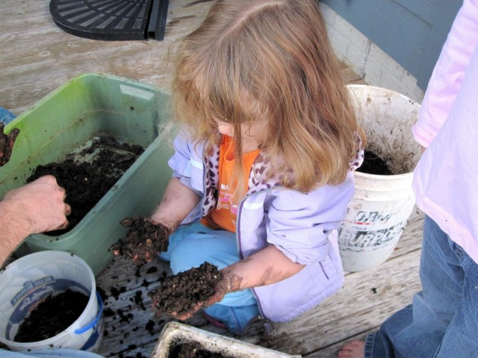 girl sorting vermicompost